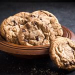 Homemade chocolate chip cookies in the wooden plate,selective focus